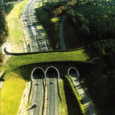 Providing crossing infrastructure at key points along transportation corridors is known to improve safety, reconnect habitats and restore wildlife movement. Throughout Europe, Asia, Australia and North American, wildlife crossing structures have been implemented with demonstrable success.