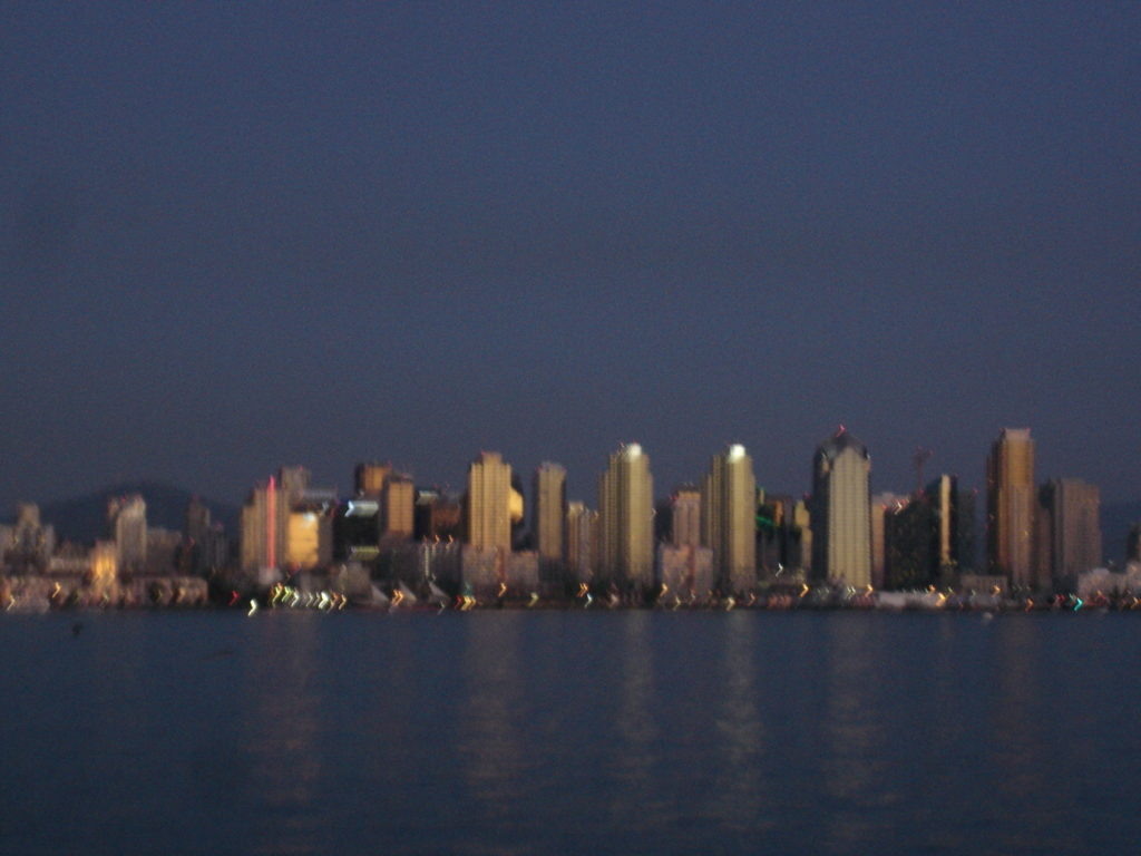 Downtown towers shimmer along San Diego Bay